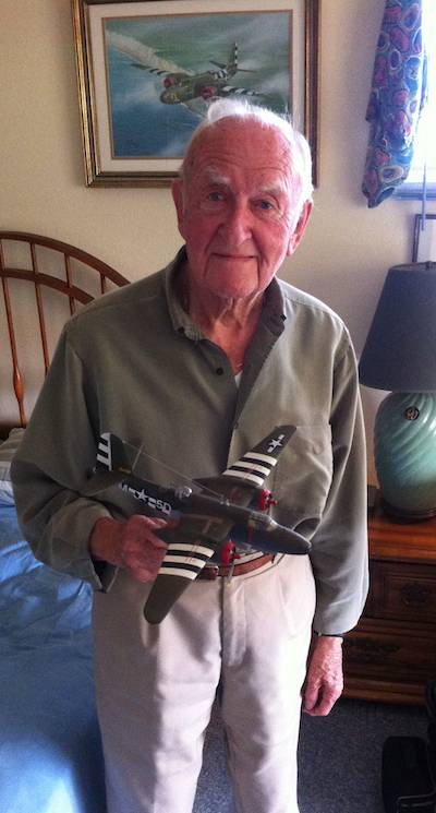 "91-year-old Karl Haeuser in his Cayucos home, with a model of the A-20 Havoc, ""Mopsy,"" that he was in when it was shot down on August 4, 1944."