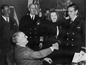 Butch O'Hare, accompanied by his wife, Rita, receiving the Medal of Honor from President Franklin D. Roosevelt.