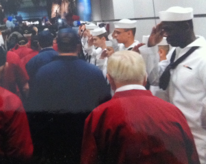 Gordon Scott being saluted by active duty sailors from NAS Lemoore upon returning from Central Valley Honor Flight (photo courtesy of Larry McFarland)
