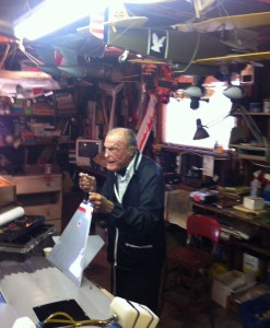 Robert Thacker in his model airplane-filled garage. For more photos, visit the Hometown Heroes facebook page.