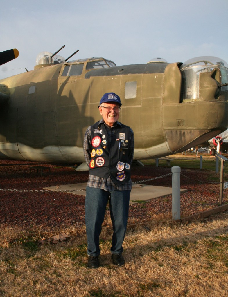 Ed Nacey in front of a B-24 at Castle Air Museum.