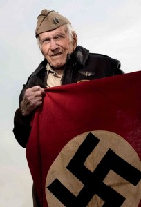 Louis Zamperini with the Nazi flag he liberated after running in the 1936 Olympics in Berlin.