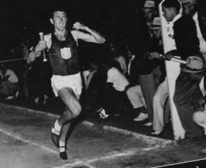 Louis Zamperini taking the tape at the West Coast Relays in Fresno, CA