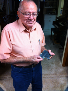 94-year-old Bob Bower holding a piece of the wing of his F6F Hellcat.