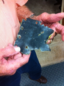 The shrapnel-ridden piece of Bob's wing that he's held on to since 1945.