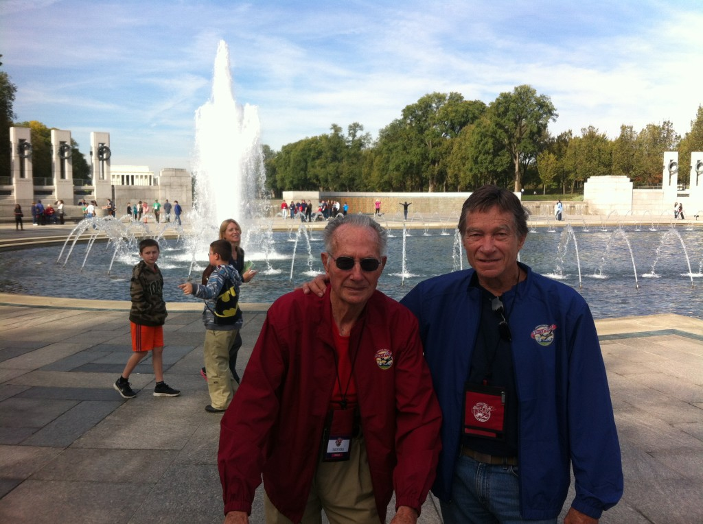 93-year-old WWII Army veteran Charles Stines at the National World War II Memorial with his son, Darryl, an Army veteran from the Vietnam era.