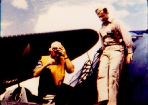 Ensign Eddy Fayle (right) on the wing of his TBD, aboard the USS Hornet in May 1942. This image is taken from the film John Ford made to memorialize the men of Torpedo Squadron 8 who died at Midway.