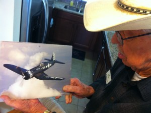 Al Rasmussen pointing out an F4U Corsair. Al's duties at Northrop Aircraft included work on the Corsair's wings.