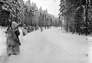 82nd Airborne troops trudge through the snow during the Battle of the Bulge.