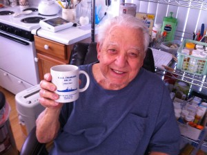 "Harold ""Hal"" Loew with a mug depicting his WWII battleship, the USS Colorado."