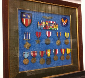 Bill's medals on display at the Warhawk Air Museum. They include the Distinguished Flying Cross, Air Medal, and Bronze Star.