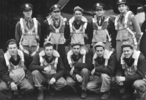 Eugene Mould (standing, second from right) as a 21-year-old bomber pilot leading a crew of a ten.
