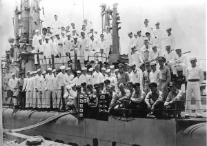The crew of the USS Sea Robin (SS-407) celebrating victory after World War II.