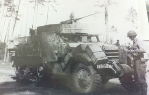George was riding in the back of an 11th Armored half track like this one when a German artillery shell hit the vehicle.