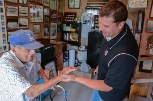 George shows me his Lifetime Achievement ring from the Professional Baseball Scouts Foundation.