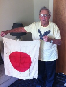88-year-old George Christman with the Japanese flag he captured on Okinawa on April 1, 1945.