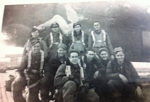 Jim Roach (standing, second from left), and his B-24 crew with the 485th Bomb Group, 830th Squadron.