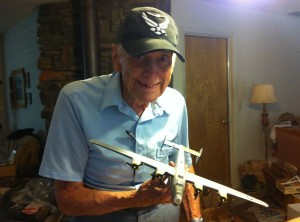 Bob Austin with a model of a B-24 like the ones he flew during World War II. For more photos, visit the Hometown Heroes facebook page.