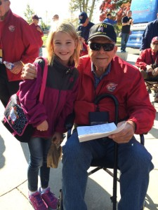 Jim with a young girl who handed him a letter of thanks at the National World War II Memorial.