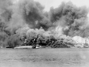 The USS Oklahoma capsizing on December 7, 1941.