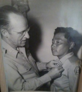 Joe receiving the Distinguished Service Cross in 1945.