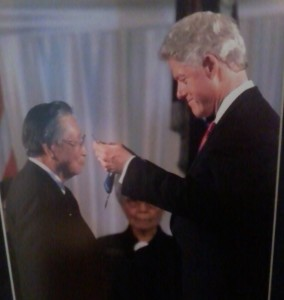 President Bill Clinton hangs the Medal of Honor around Joe's neck in 2000.