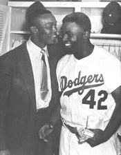 The man who broke baseball's color barrier, Jackie Robinson, with the man who turned down that role, Monte Irvin.