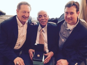 Monte Irvin receiving a World Series ring in 2015 from San Francisco Giants' President/CEO Larry Baer (left) and General Manager Bobby Evans (right)