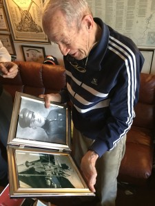 Dick Over looking at photographs of his father, a U.S. Marine Corps veteran of World War I.