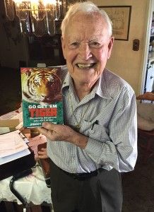 Jimmy Weldon with his book, Go Get 'Em Tiger.