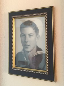 91-year-old Bob Dodds reflected in a photo of his 17-year-old sailor self. For more photos, visit the Hometown Heroes facebook page.