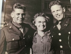 Doug (left) and Bert Justus with their mother during World War II.