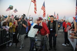 Al Peguero receives a warm welcome home from his 2014 Honor Flight at Castle Airport. (photo by Kendyl Day)