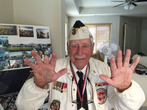 Wally shows us the finger that was a casualty of his desire to join the Navy. For more photos, visit the Hometown Heroes facebook page.