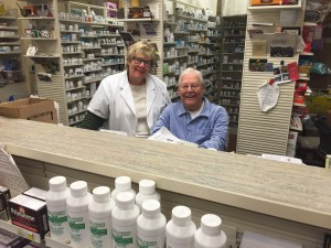 Mert with his daughter, Lynn Taylor, at Bullard Pharmacy in Fresno, CA, where Mert continues to put his pharmacist's license to work.