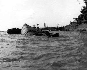 "The capsized hull of the battleship USS Oklahoma, where Richard ""Swede"" Artley was trapped for 34 hours."