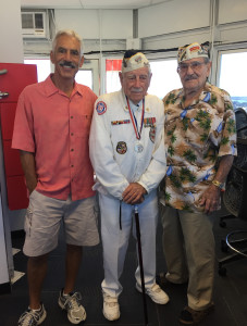 "Chester ""Ski"" Biernacki (right) and Delton ""Wally"" Walling (center) with Chace Anderson inside the observation tower at Pearl Harbor on December 6, 2016. (photo courtesy: Chace Anderson)"