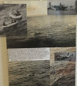 Scenes from Asbury's 1944 rescue adorn his wall in Albuquerque.