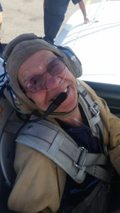 Asbury in the cockpit of a World War II-era Stearman biplane.